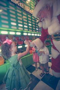 Allie-Kate, Eli,  and Ella Grace meet Santa
