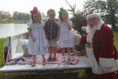 Allie-Kate, Eli, and Ella-Grace meet Santa