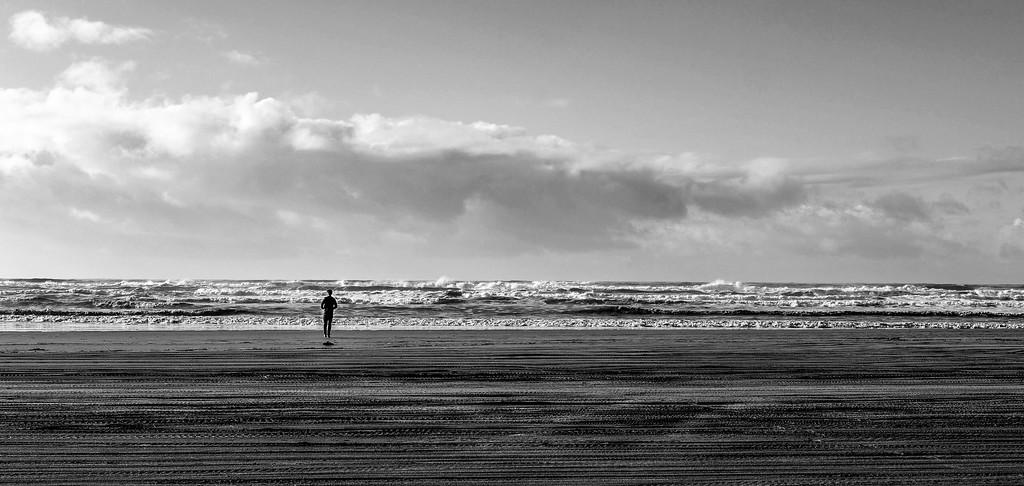 Minimal People - thoughtful on the beach. Copalis Beach, Washington.