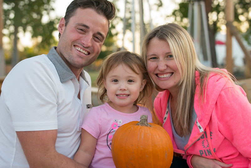 Family posing for autum photo