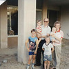 Clay & Darlene and boys in front of newly purchased Telheiras church storefront