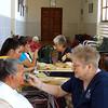 Sister Karen Elliott feeds a patient at Santo Hermano Pedro