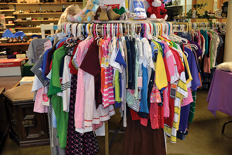 Clothes hang from the racks at the thrift store at St. Joseph the Worker Mission in Elkhorn City. Sister Margie oversees the store as part of her ministry in southeastern Kentucky.