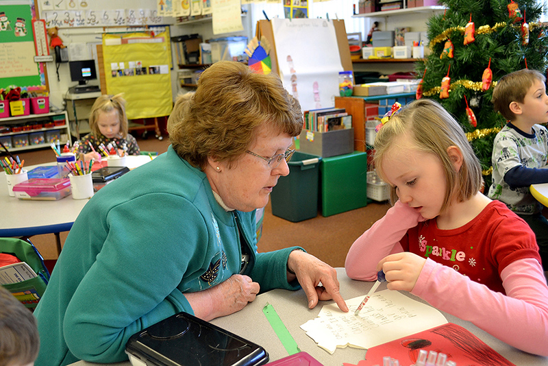 Sr. Nancy Wolf works with kindergartener Bridget Fullenkamp at Immaculate Conception School.