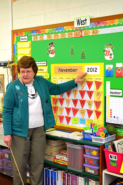 Sister Nancy Wolf teaches her kindergarten class dates and numbers at Immaculate Conception School in Celina.
