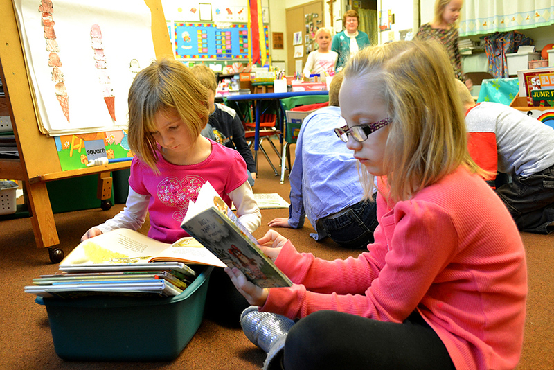 Kindergarteners Kaitlyn Muhlenkam, left, and Madilynn Link read in Sister Nancy Wolf's class at Immaculate Conception School in Celina.