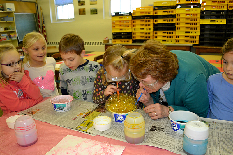 Sister Nancy Wolf leads kindergartners in art class at Immaculate Conception School in Celina. From left, Madilynn Link, Kenlee Holstad, Noah James, Cora Schumm and Ayria Rutledge.