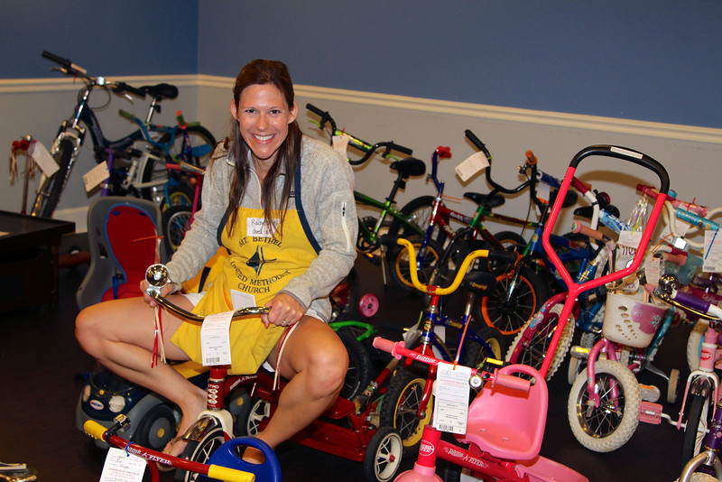 Rachel is right at home in the bicycle room!