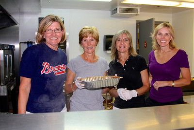 New Century Circle Ladies serving dinner at MUST. One of the many fun things we do each year.