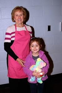 Volunteer Dee with her granddaughter.