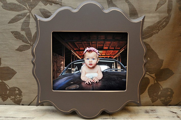"8x10 ""bombay"" frame in espresso<br /> <br /> Frames are handmade with pressed wood and a cost of satin finish for protection.  Distressed wood, by nature, will have minor imperfections which lend to the vintage feel of the frame."