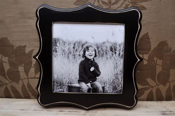 """10x10 """"tuscan"""" frame in black.<br /> <br /> <br /> Frames are handmade with pressed wood and a cost of satin finish for protection.  Distressed wood, by nature, will have minor imperfections which lend to the vintage feel of the frame."""