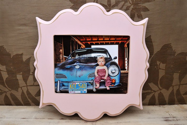 """8x10 """"bombay"""" frame in pink.<br /> <br /> Frames are handmade with pressed wood and a cost of satin finish for protection.  Distressed wood, by nature, will have minor imperfections which lend to the vintage feel of the frame."""
