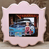 "8x10 ""bombay"" frame in pink.<br /> <br /> Frames are handmade with pressed wood and a cost of satin finish for protection.  Distressed wood, by nature, will have minor imperfections which lend to the vintage feel of the frame."
