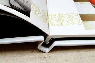Seam of a book, which differs from the seam of an album.