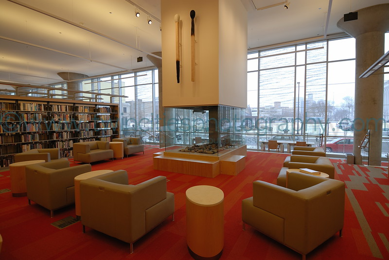 """<font size=""""2"""" face=""""Verdana"""" font color=""""#84C65D"""">A sitting area with fireplace on the 1st floor of the library.</font>"""