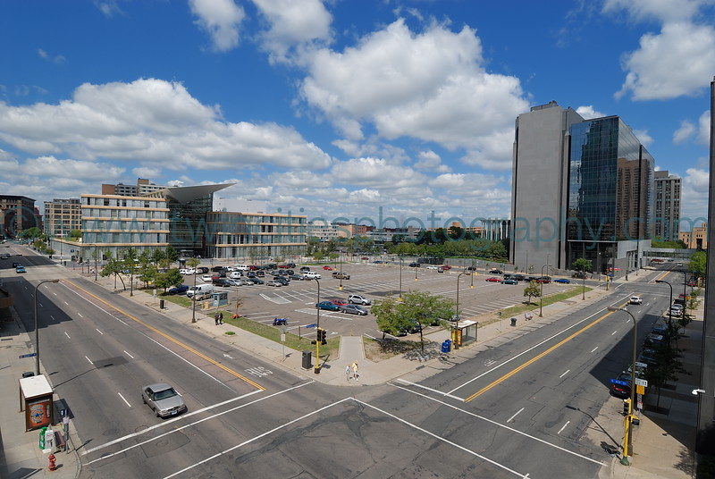 #9491 - Wide angle view of the new library and the surface parking lot between Marquette and Nicollet avenues. August 2006