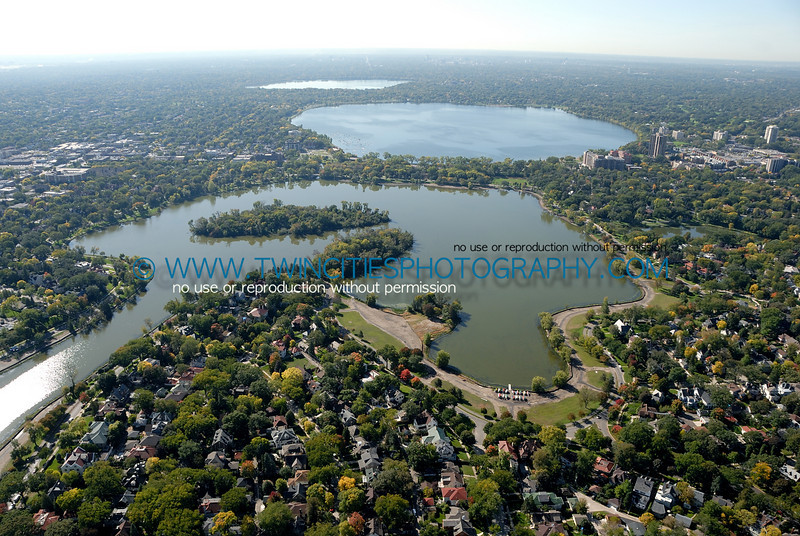 "<font size=""2"" face=""Verdana"" font color=""#5CB3FF"">Aerial view of Lake of the Isles from the North end of the lake.  Lake Calhoun and Harriet are visible at the upper portion of the photo.  September 28, 2007.</font>"