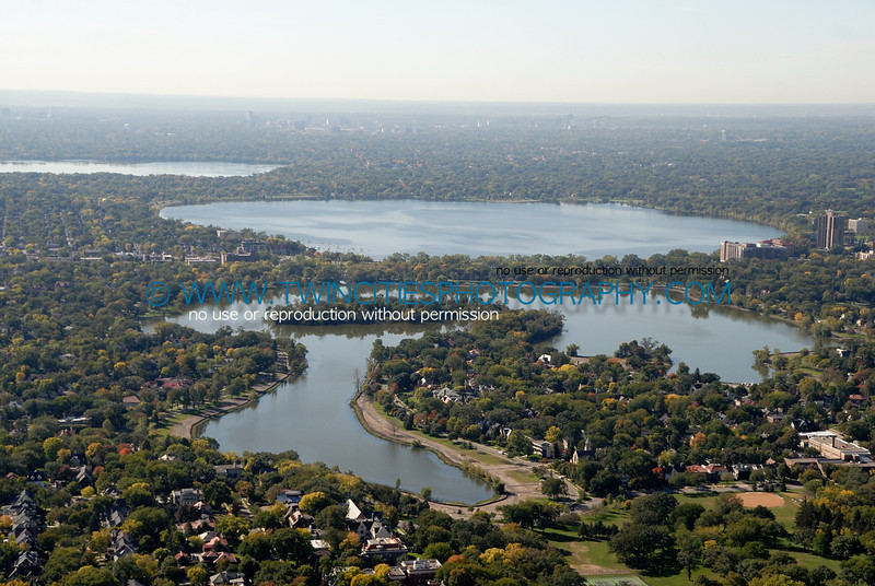 """<font size=""""2"""" face=""""Verdana"""" font color=""""#5CB3FF"""">Aerial view of Lake of the Isles from the North end of the lake.  Lake Calhoun and Harriet are visible at the upper portion of the photo.  September  28, 2007.</font>"""