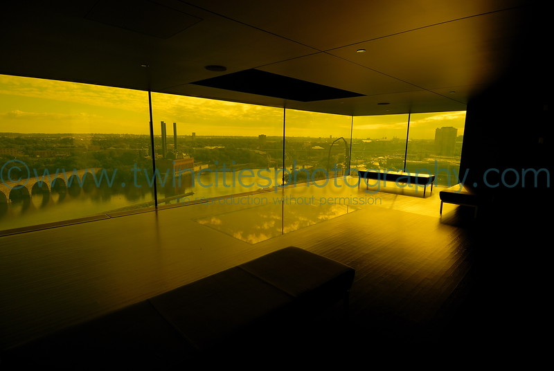 """<font size=""""2"""" face=""""Verdana"""" font color=""""#5CB3FF"""">View of the Dowling Studio lobby area with a view of the Mississippir River through the amber glass - August 2007.</font>"""
