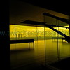 """<font size=""""2"""" face=""""Verdana"""" font color=""""#5CB3FF"""">A staircase in the lobby of the Dowling studio offers a slightly differnt view of the amber glass sitting area overlooking the Mississippi Riverfront - August 2007</font>"""