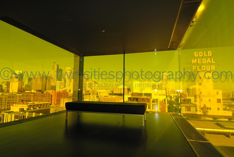 """<font size=""""2"""" face=""""Verdana"""" font color=""""#5CB3FF"""">Downtown Minneapolis and the Gold Medal Flour historic mill as viewed through the amber colored glass on the 9th floor of the Guthrie Theater - August 2007.</font>"""