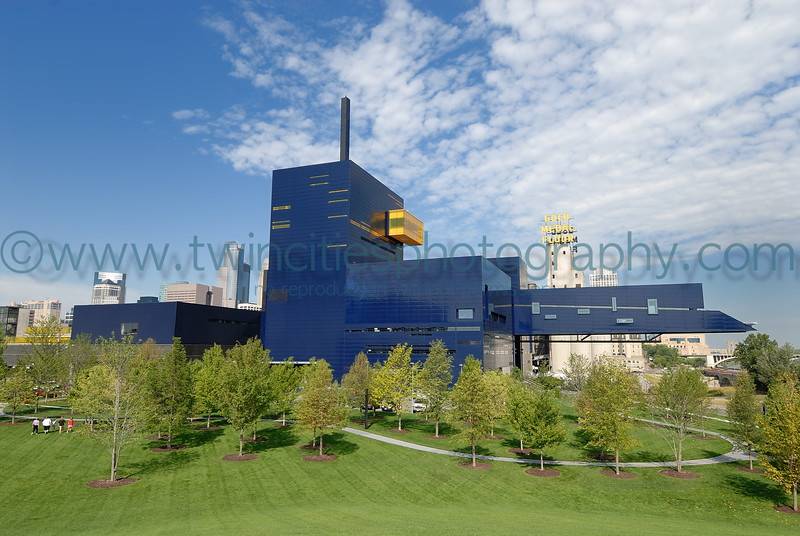 """<font size=""""2"""" face=""""Verdana"""" font color=""""#5CB3FF"""">July 28, 2007 - View of the Guthrie from Gold Medal Park - downtown Minneapolis is visible in the background.</font>"""