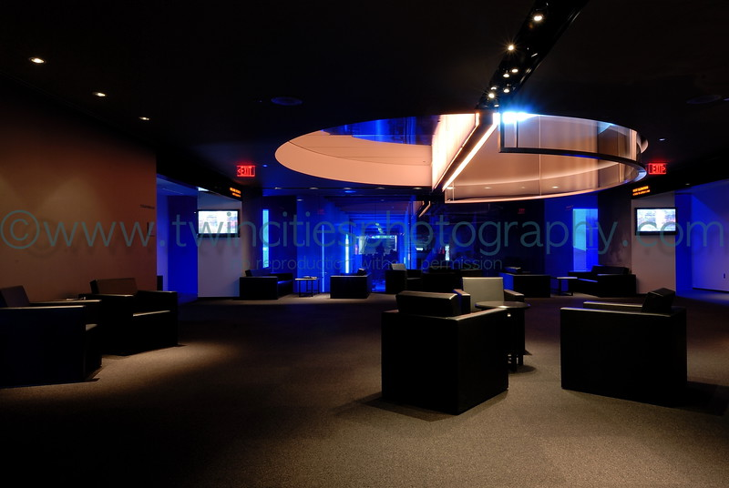 """<font size=""""2"""" face=""""Verdana"""" font color=""""#5CB3FF"""">This is the lobby area on the 4th floor of the Guthrie Theater.  The area behind the blue glass is the skyway which connects the Guthrie set construction area to the main building.September 2007.</font>"""