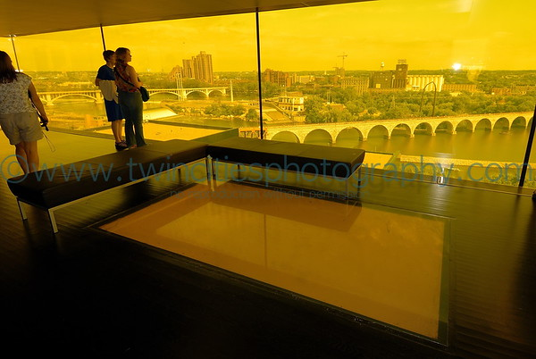 The amber glass of the Dowling Studio offers a great view of the historic Stone Arch Bridge crossing the Mississippi River.  Visitors the lobby can also look down through the glass panel in the floor of the lobby area.