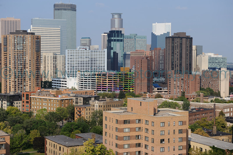 "<font size=""3"" face=""Verdana"" font color=""white"">Loring Park -</font> <font size=""2"" face=""Verdana"" font color=""#5CB3FF"">View of downtown Minneapolis and the Loring Park area.  Photo date September 2009</font> <br>"