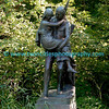 "#6424 - The life-size bronze sculpture by Jakob Fjelde (also of Ole Bull and Minerva fame) depicts Hiawatha and Minnehaha, characters from the poem ""Song of Hiawatha"" by Henry Wadsworth Longfellow. It bears the inscription: <br /> Over wide and rushing rivers <br /> In his arms he bore the maiden. <br /> On exhibit at the Chicago World's Fair in 1893, the sculpture was purchased with pennies donated by school children in Minnesota – an effort organized by Mrs. L.P. Hunt of Mankato – and dedicated in 1912. The sculpture, which rests on a small island in the creek, can be viewed from the water's edge a short way above the falls."
