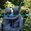 "#6427 - The life-size bronze sculpture by Jakob Fjelde (also of Ole Bull and Minerva fame) depicts Hiawatha and Minnehaha, characters from the poem ""Song of Hiawatha"" by Henry Wadsworth Longfellow. It bears the inscription: <br /> Over wide and rushing rivers <br /> In his arms he bore the maiden. <br /> On exhibit at the Chicago World's Fair in 1893, the sculpture was purchased with pennies donated by school children in Minnesota – an effort organized by Mrs. L.P. Hunt of Mankato – and dedicated in 1912. The sculpture, which rests on a small island in the creek, can be viewed from the water's edge a short way above the falls."
