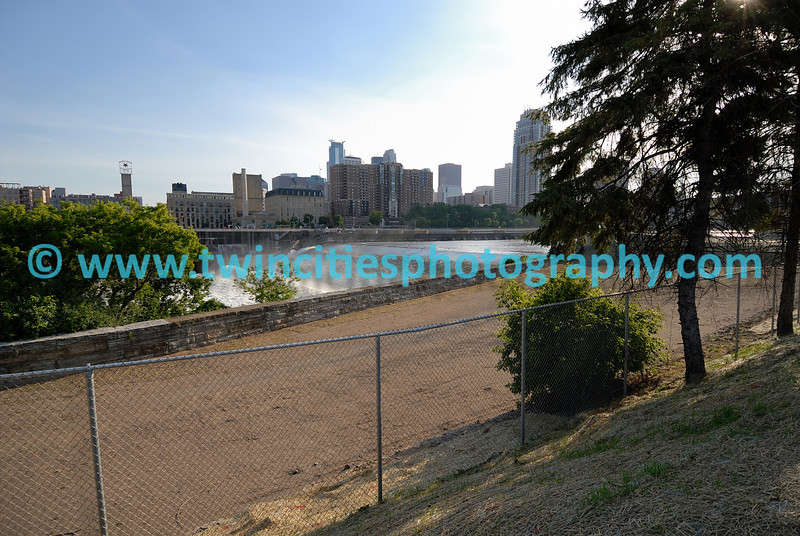 """<font size=""""2"""" face=""""Verdana"""" font color=""""#84C65D"""">View of St. Anthony Falls from the newly opened park, St. Anthony Falls Park, on the Mississippi River near downtown Minneapolis. (June 2007)</font>"""