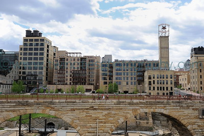 Mississippi Riverfront Lofts and Condos along the riverfront near downtown Minneapolis, with the historic Stone Arch Bridge in the foreground.  Click on photo to see larger size.