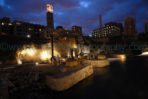 Night time view of the mill ruins area next to the Stone Arch Bridge.