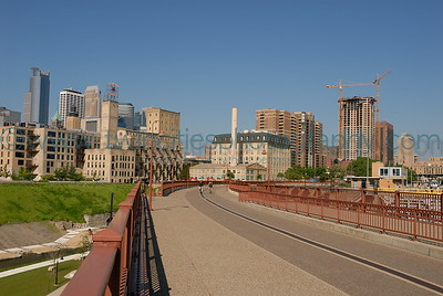 Stone Arch Bridge looking towards downtown Minneapolis.  The new Carlyle Condominium tower under construction - May 2006