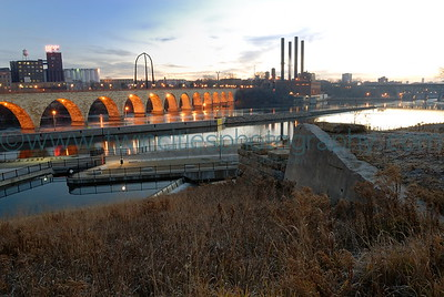 Mississippi Riverfront Early morning photo of the historic Stone Arch Bridge near downtown Minneapolis.  Click on photo to see larger size.