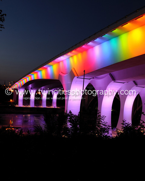 """<font size=""""3"""" face=""""Verdana"""" font color=""""white"""">2011 35W Bridge Lighting</font> <font size=""""3"""" face=""""Verdana"""" font color=""""#5CB3FF"""">The Interstate 35W Bridge in Minneapolis illuminated with rainbow colors the night of June 24th in celebration of this years pride festival.</font> <br> <font size = """"1"""" font color = """"gray"""">Click on photo to see larger size.</font>"""