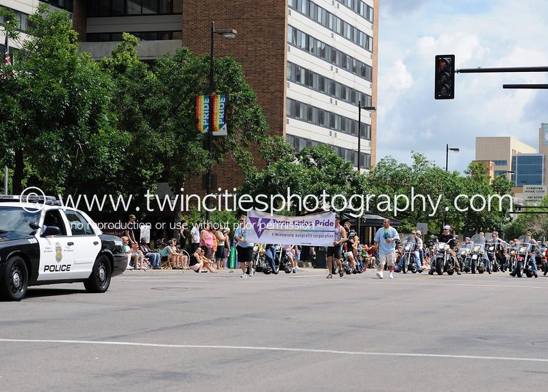 "<font size=""3"" face=""Verdana"" font color=""white"">2010 Twin Cities Gay Pride Parade</font> <font size=""3"" face=""Verdana"" font color=""#5CB3FF"">The parade route was along Hennepin Avenue in downtown Minneapolis - June 27, 2010.</font> <br> <font size = ""1"" font color = ""gray"">Click on photo to see larger size.</font>"