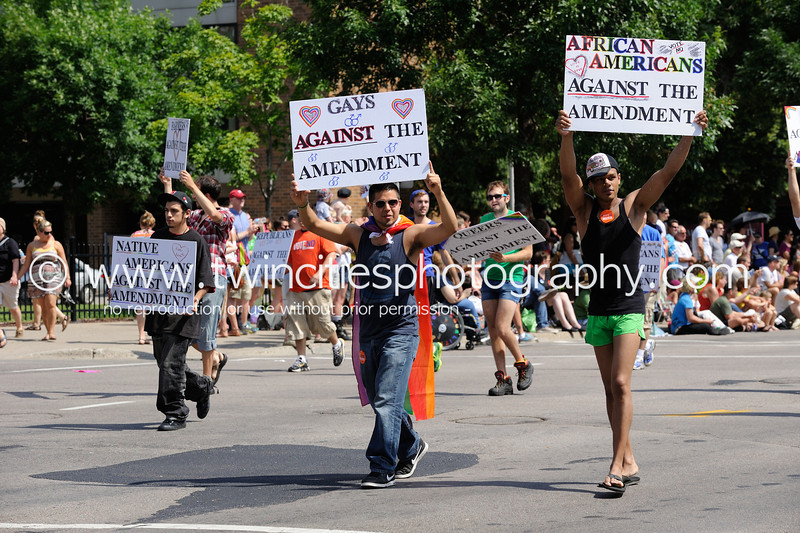 "<font size=""3"" face=""Verdana"" font color=""white"">2012 Minneapolis Gay Pride Parade</font> <font size=""3"" face=""Verdana"" font color=""#5CB3FF"">The parade route was along Hennepin Avenue in downtown Minneapolis - June 2012.</font> <br> <font size = ""1"" font color = ""gray"">Click on photo to see larger size.</font>"