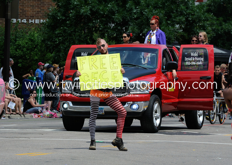 """<font size=""""3"""" face=""""Verdana"""" font color=""""#5CB3FF"""">2012 Twin Cities Gay Pride Parade <br>June 24, 2012 along Hennepin Avenue in downtown Minneapolis.</font>"""