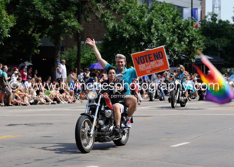 "<font size=""3"" face=""Verdana"" font color=""white"">2012 Minneapolis Gay Pride Parade</font> <font size=""3"" face=""Verdana"" font color=""#5CB3FF"">The parade route was along Hennepin Avenue in downtown Minneapolis - June 2012.</font> <br> <font size = ""1"" font color = ""gray"">Click on photo to see larger size.</font>"