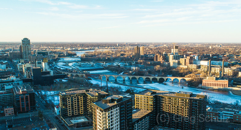 Midwinter Sunset Mississippi River View Stone Arch Bridge and Downtown Minneapolis
