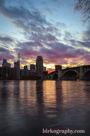 Late October sunset behind Minneapolis and the 3rd Ave. bridge.  Shot from St. Anthony Main, Riverside.