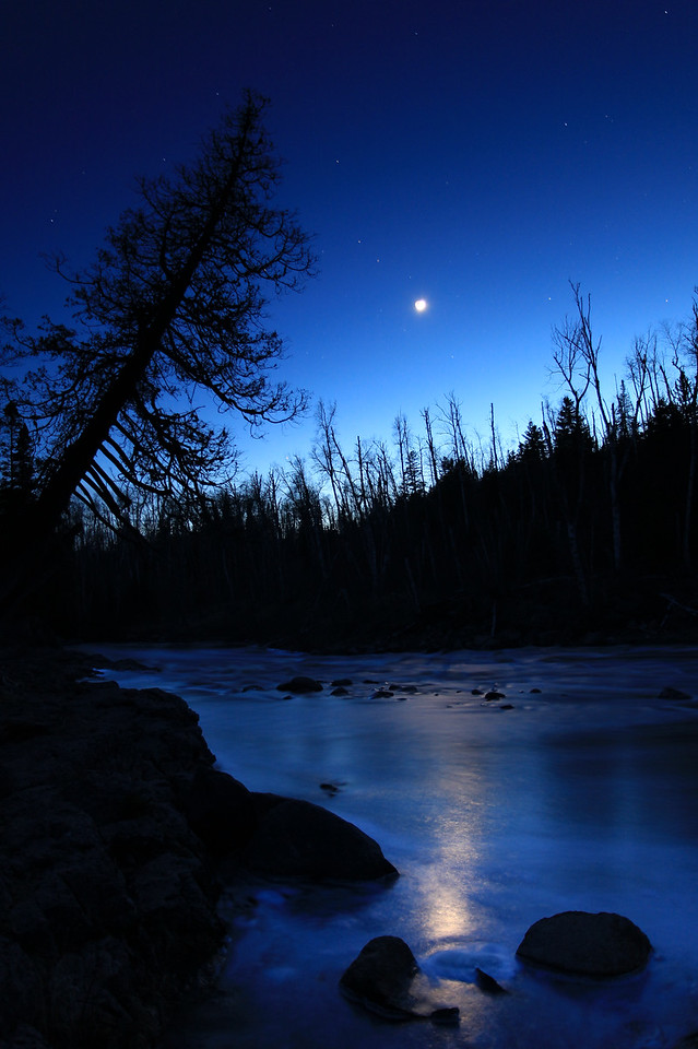 "RIVERS 0103<br /> <br /> ""Temperance River Twilight""<br /> <br /> The crescent moon approaches the horizon as the last light of day fades from the sky on May 6, 2011 at Temperance River State Park, MN."