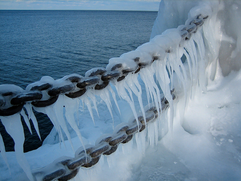 Heavy chain frozen in ice.