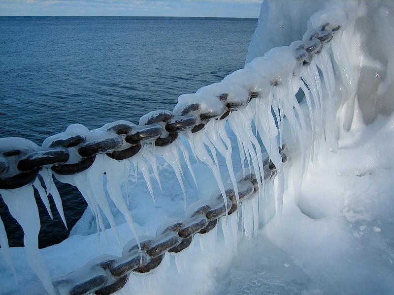 Heavy chain frozen in ice.