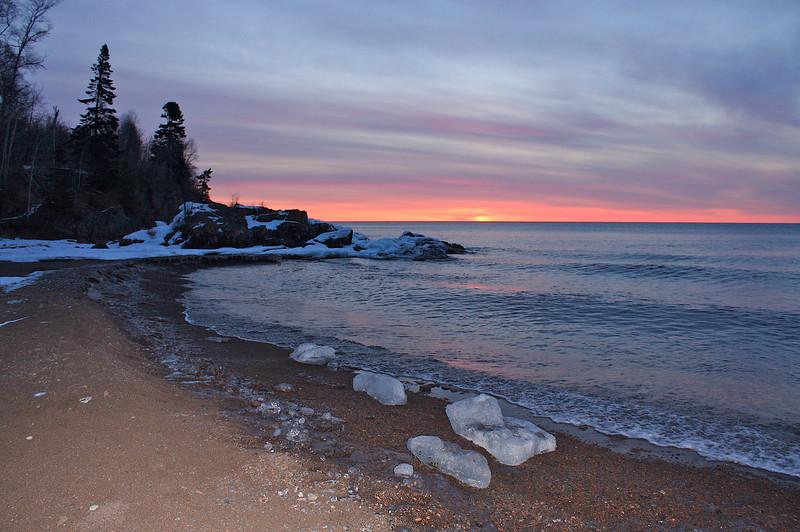 Winter Ice along the shore of lake Superior at sunrise.
