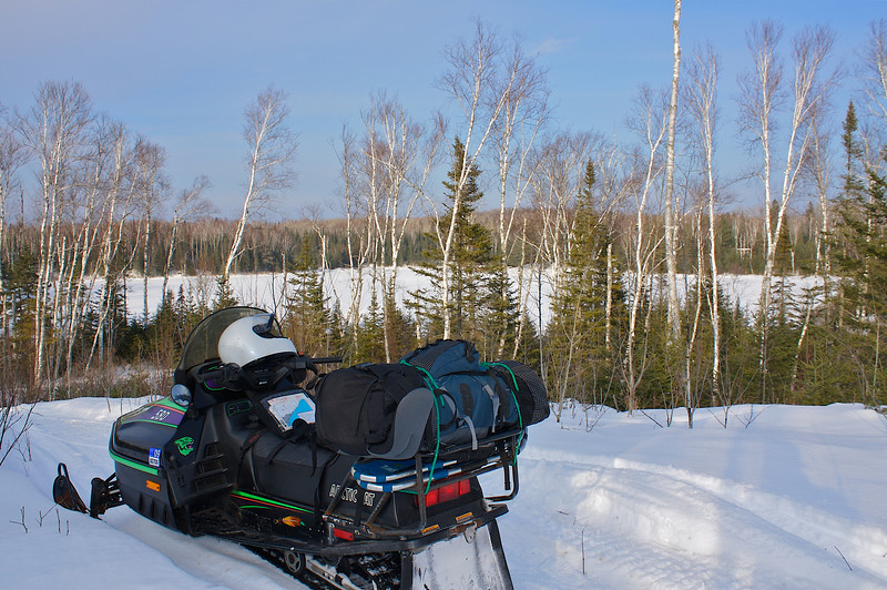 Winter camping by snowmobile.