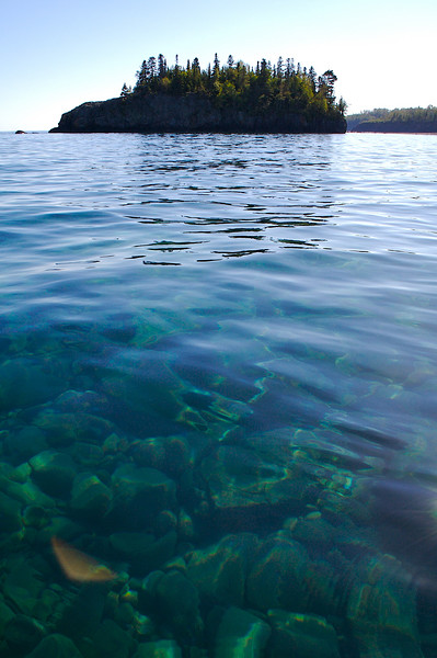 I'm in my kayak in deep clear water. I found smaller waves in this sheltered area.